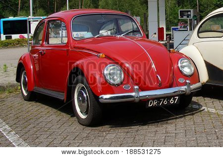 Wageningen, The Netherlands - May 29, 2017: Red Volkswagen Type 1 parked on a public parking lot in the city of Wageningen. Nobody in the vehicle. The VW T1 is also known as Beetle, Bug and Kafer.