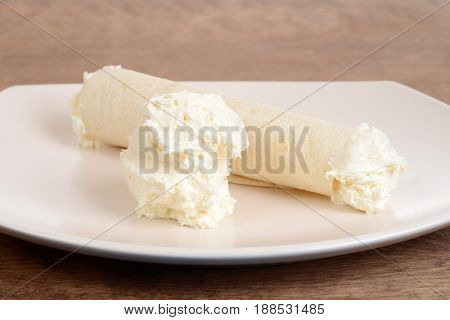 closeup vanilla ice cream crepe on a plate