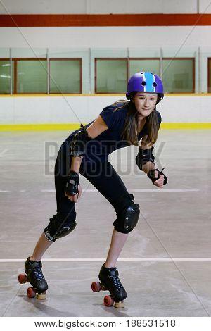 teen girl roller derby standing on toe stops
