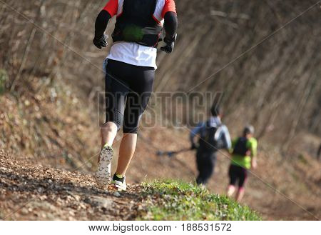 Group Of Athletes Running The Country Race In Mountain In Winter