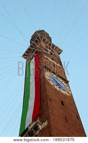 Bell Tower With Enormous Italian Flag In  Vicenza City In Northern Italy