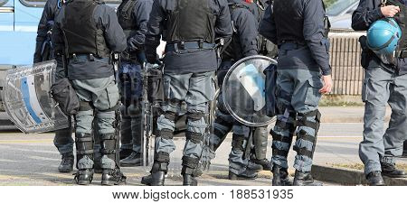 Group Of Riot Police With Batons And Shields During Security Checks Through The Streets Of The City
