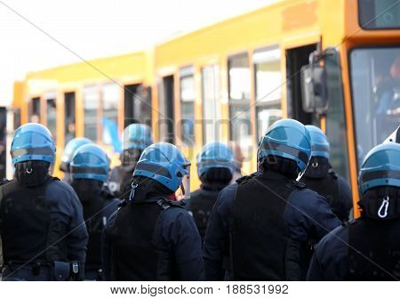 Riot Police With Protective Helmet Escort The Buses Of Fans