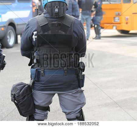 Riot Police Officer And Bulletproof Vest During A Protest