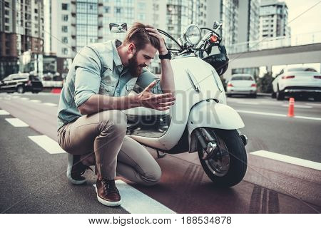 Guy Having A Problem With Scooter