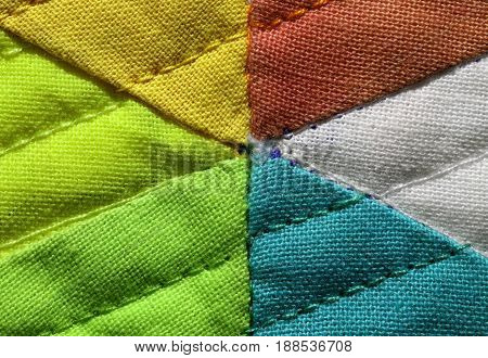 Embroidery Of Colorful Fabric  Photographed With A Macro Lens