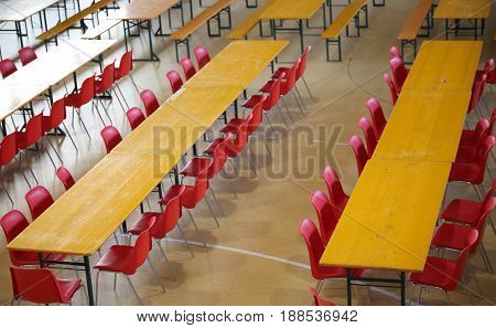 Long Table With Red Chairs In A Wide Classroom
