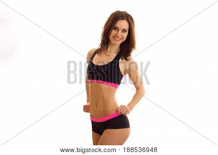 horizontal portrait of cheerful young sports brunette in uniform isolated on white background