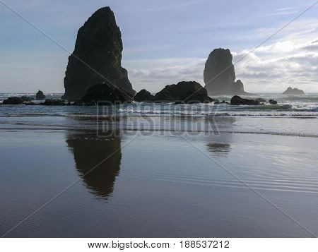 beach with rock formation at low tide just before sunset