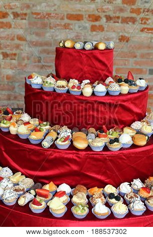 Pyramin Of Pastries With Cream And Fruit
