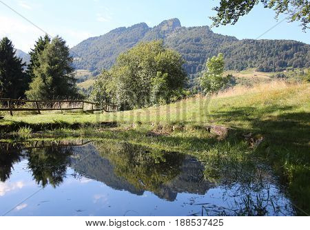 Little Lake And The Mountains In Northen Italy