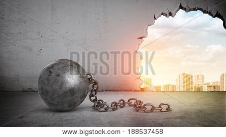 A black wrecking ball and hole in a concrete wall showing city landscape. Old building demolition. New construction site. Freshen up your life.