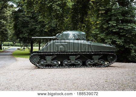 Oosterbeek Netherlands - August 09 2016: Sherman battle tank in the garden of Airborne Museum Hartenstein. It is dedicated to the Battle of Arnhem in which the Allied Forces attempted to form a bridgehead on the northern banks of the Rhine river