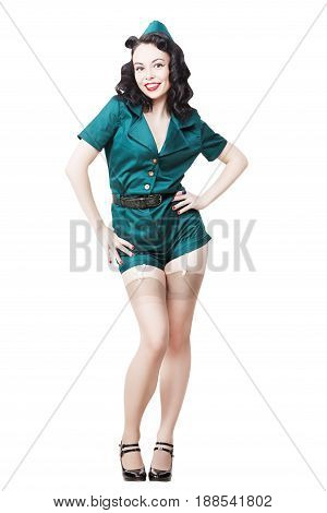 Portrait of Beautiful Brunette with black hair. Pin up Female Dressed in military clothing Uniform and Garrison cap. Army Pin-up Girl moving swinging hips