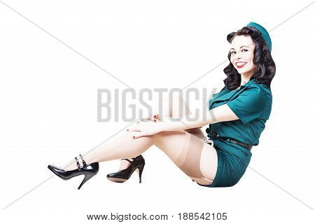 Portrait of Beautiful Brunette with black hair. Pin up Female Dressed in military clothing Uniform and Garrison cap. Army Pin-up Girl Concept