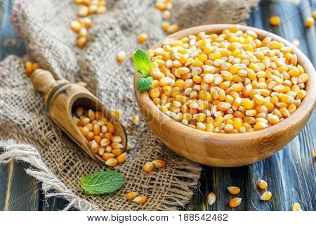 Corn For Popcorn In The Bowl And Wooden Scoop.