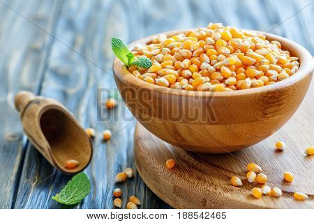 Grain Of Corn In A Wooden Bowl.
