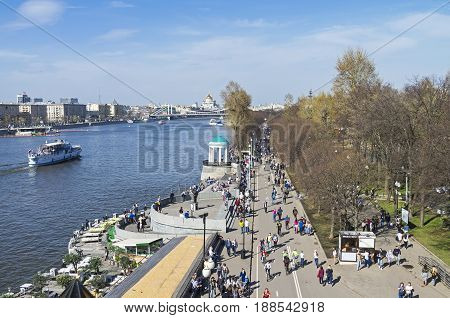 MOSCOW RUSSIA APRIL 29 2017: People on Pushkinskaya embankment on a warm April day. Moscow Russia.