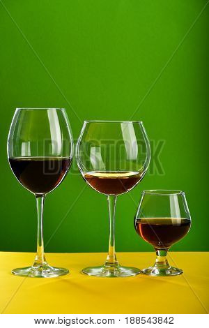 Concept Of Beverage Degustation: Alcoholic Beverages In Different Glasses