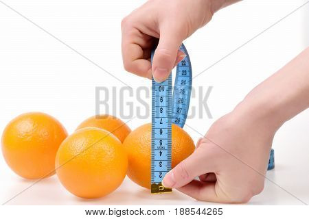 Hands Of Women With Blue Measuring Tape Metering Oranges