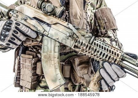 Close-up shot of Kalashnikov rifle automatic weapons in hands of army special forces soldier isolated on white background