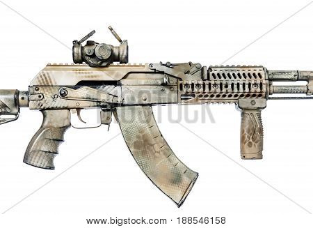 Close-up shot of Kalashnikov rifle with collimator and fire control handle, automatic weapons isolated on white background. Gun is painted desert camouflage