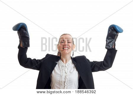 Cheerful strong business woman in classic uniform with boxing gloves and hands in the air isolated on white background