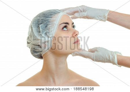 dermatologist in gloves for a girl's face prepares analyses close-up isolated on white background