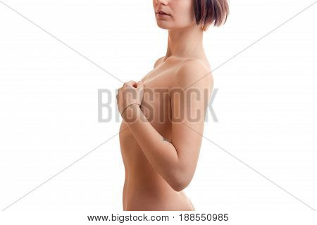 Slim young girl closed her hands chest close-up isolated on white background