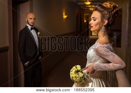 Family portrait of just merried young elegant couple