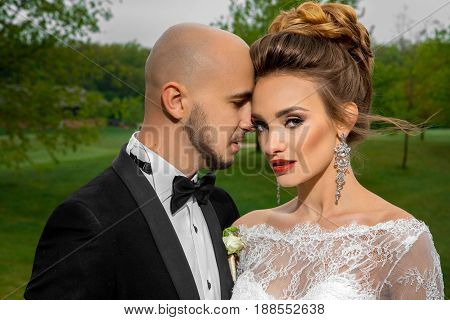 close up portrait of beautiful juest merried couple hugging outdoors