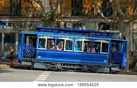Blue tram goes to Plaza del Doctor Andreu where it connects with the Tibidabo funicular railway - Barcelona Catalonia Spain, 2 September 2007