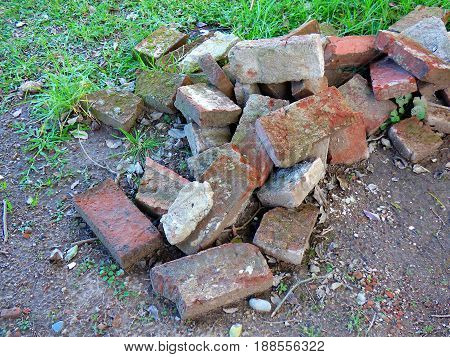 Discarded bricks. Bricks heap. Wasted bricks. Bunch of bricks. Pile of bricks. Masonry poster