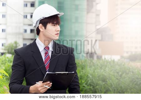 asian construction business man working  on take note.