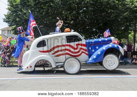 BRISTOL RHODE ISLAND - JULY 4 2011: Red white and blue wheelie machine at the Fourth of July parade in Bristol Rhode Island