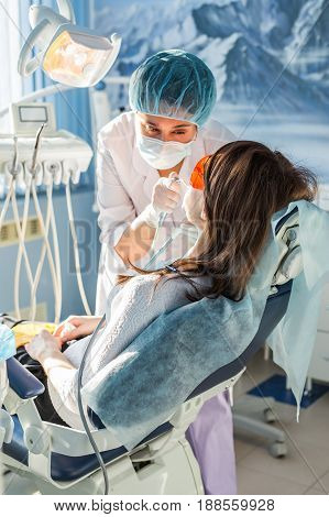 Young woman getting dental treatment. dental clinic