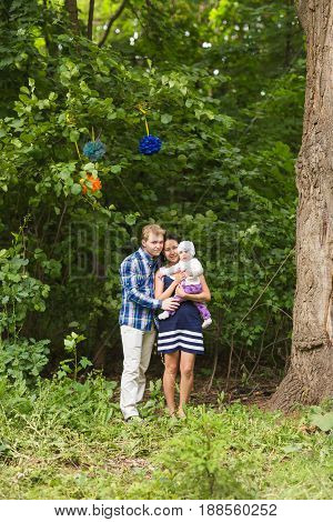 Portrait of mixed race family on nature.