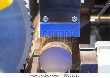 The circular saw for cutting metal rod.Industrial equipment.