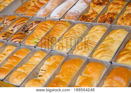Bread In The Aluminium Box. Fresh Buns For Sale From The Oven. Baking Bread. Transportation Of Bakin
