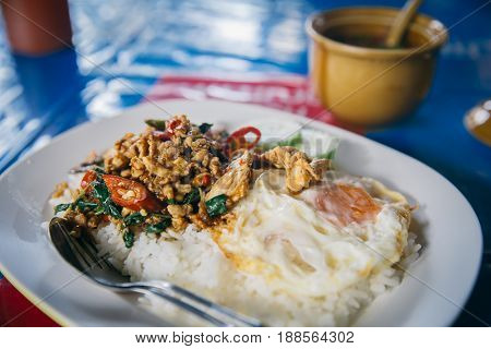 Thai Simple Meal. Street Food In Thailand Jasmine Rice With Stir-fried Of Chicken And Basil Leaf Wit