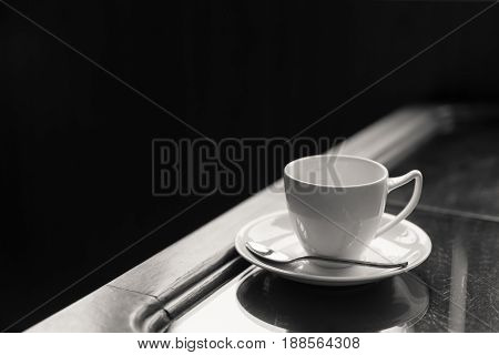 Single White Cup Of Espresso Hot Coffee On Glass Table In Coffeeshop. Black And White Photography Li