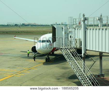 Airplane Docking At The Airport