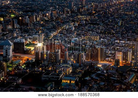 Tokyo Metropolis business buildings neon light at night.