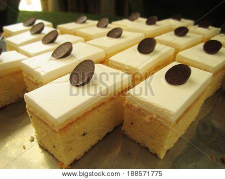 glazed lemon and poppy seed cake in on shelf in bakery or baker's shop