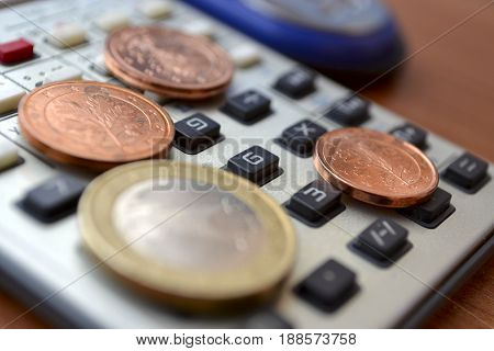 Financial background with money calculator and stapler.