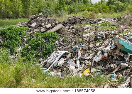 Illegal garbage dumping near the forest in the countryside
