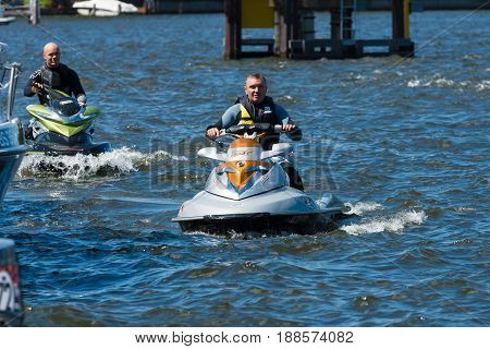 BERLIN GERMANY - MAY 03 2014: Demonstration rides on a water scooter. 2nd Berlin water sports festival in Gruenau