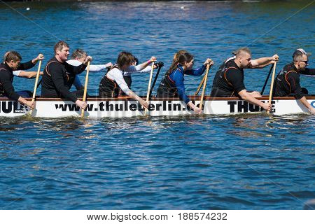 BERLIN GERMANY - MAY 03 2014: Rowers in a boat. 2nd Berlin water sports festival in Gruenau.