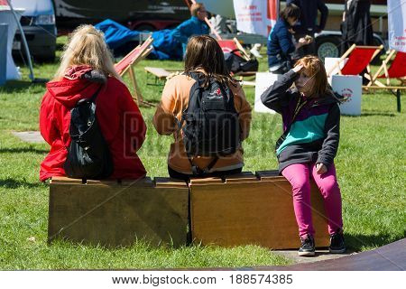 BERLIN GERMANY - MAY 03 2014: Vacationers citizens. 2nd Berlin watersports festival in Gruenau on the river Dahme tributary of the river Spree