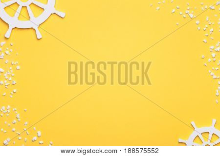 Summer holiday vacation background with rudders and sand in white. Copy space. Top view